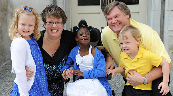 Remarkable family provides forever home to child with  of Severely developmentally delayed children