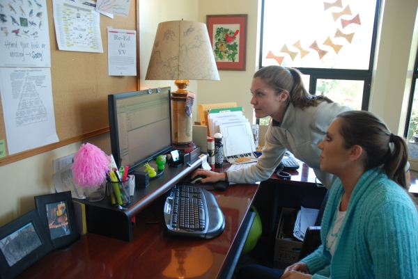 Rachel Johnson, program manager, and Alyssa Osburn, therapist, at Youth Villages Oregon work on Netsmart's Evolv-CS, a new electronic medical records system rolled out to staff this month. A grant of $7.5 million from Microsoft enhanced the new system, increasing access for users.