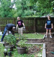 Banana Republic Factory Outlet staff replant the garden at the Binkley Group Home.