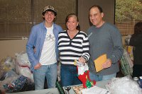 Holiday Heroes Wrapping Party - Volunteers from Father Ryan High School and Country Music Television