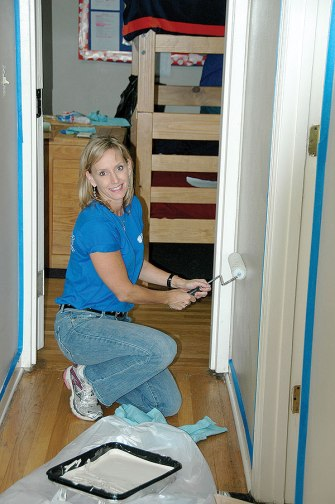 HCA volunteers repaint the entire interior of the Binkley Group Home
