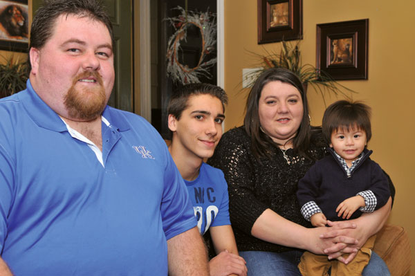 Foster parents Larry, left, and Robin, right, with Bradley and Johnathan