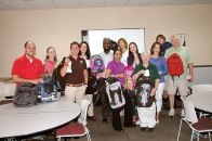 Backpack Heroes - Panera Bread Company volunteers help stuff backpacks with supplies
