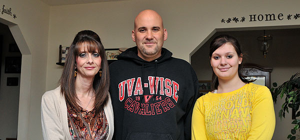 Tiana (right) with her mother, Tina, and father, David.