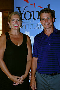 Winning professional Tim Hval of Portland Golf Club (right) with Lynne Saxton, executive director of Youth Villages Oregon.