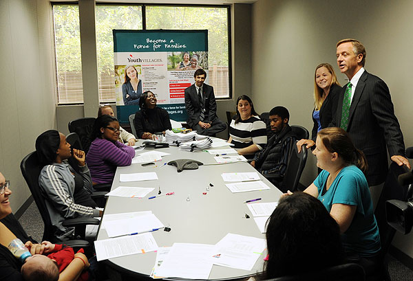 Tennessee Gov. Bill Haslam (right) speaks with youth who are part of Youth Villages' transitional living program for teens aging out of foster care.