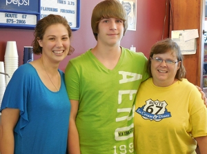 Jakob stands with counselor Megan and adoptive mom Julie
