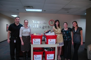 Employees from Jackson National Life participate in a book drive to supply reading materials for children receiving help in Middle Tennessee group homes.