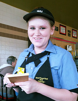 Rainey's begun management training at a local restaurant and juggles caring for two daughters with her husband.