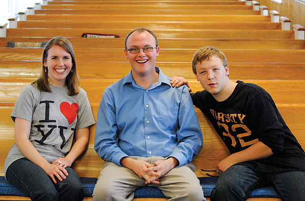 Family counselor Ashley Snedeger (left) with Brett (center) and Cole.