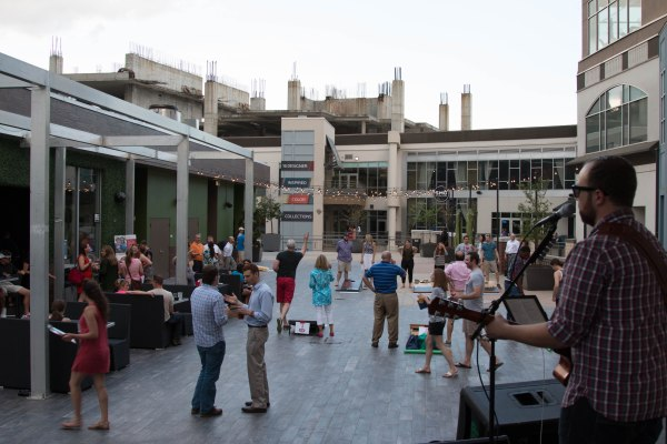 Participants compete for cornhole prizes at Rooftop210 in EpiCentre.