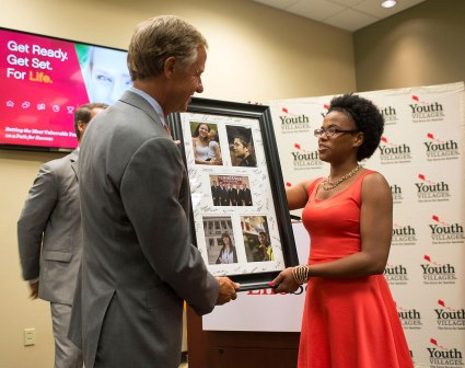 Bianca Christian, a YVLifeSet participant, presents Gov. Haslam with a gift of appreciation.
