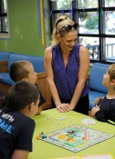 Melissa Joan Hart plays a board game with boys at Youth Villages' Bartlett Campus during her Oct. 6 visit.