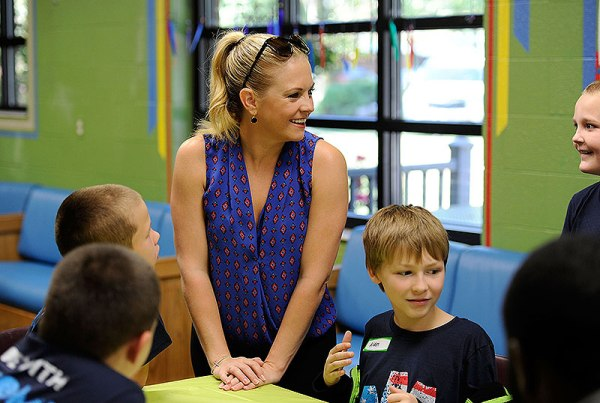 Melissa Joan Hart plays a board game with boys at Youth Villages' Bartlett Campus during her Oct. 6 visit. See more photos below.