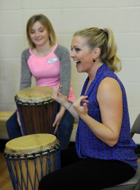 Hart joins in during a therapeutic drumming session at the Youth Villages Girls Center for Intensive Residential Treatment.