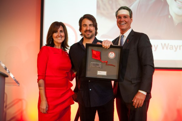 Jimmy Wayne, (center) is presented with the inaugural KiteTales Award by Annie Smith, State Director of Youth Villages North Carolina and Pat Lawler, Chief Executive Officer, Youth Villages.